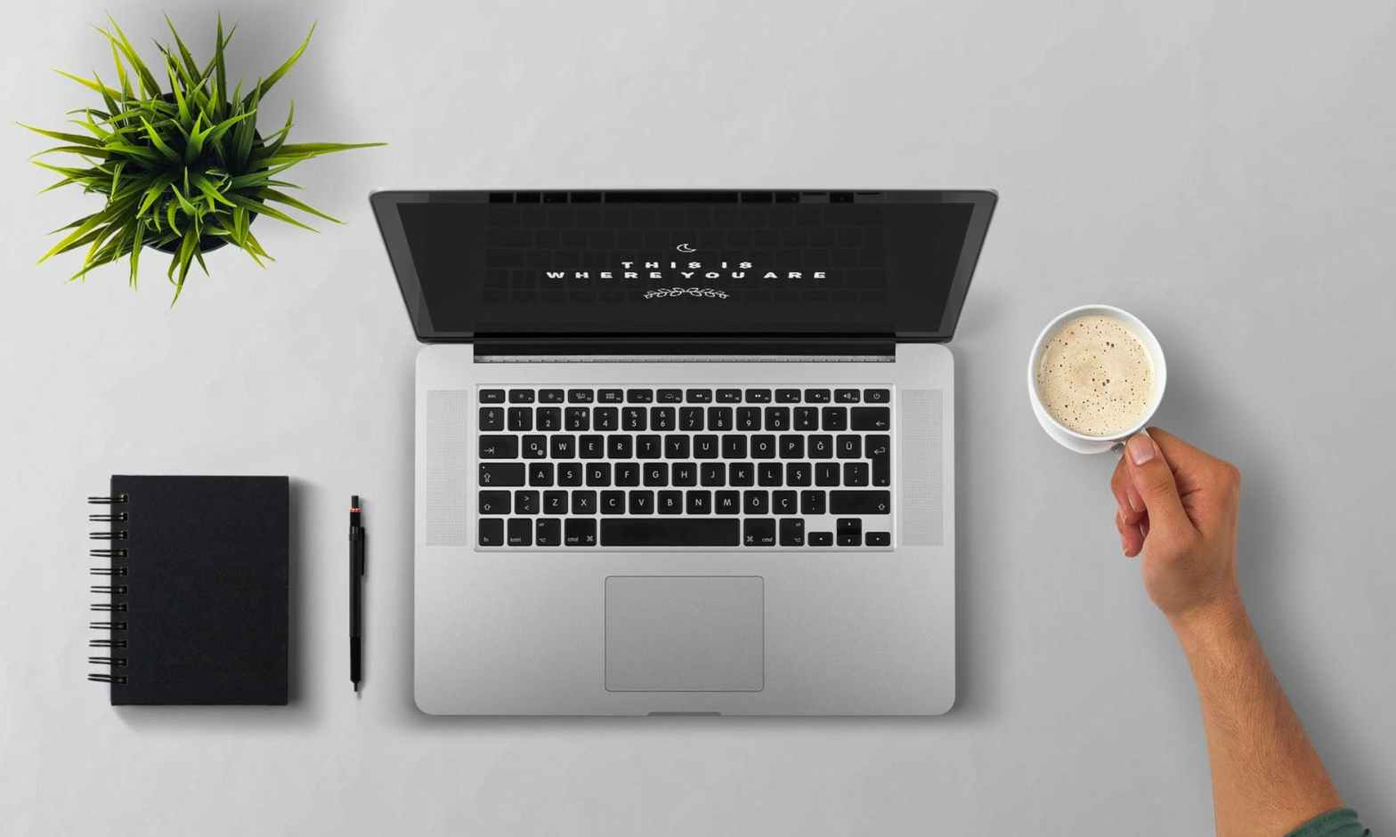 start an online business: laptop with coffee and notebook beside it