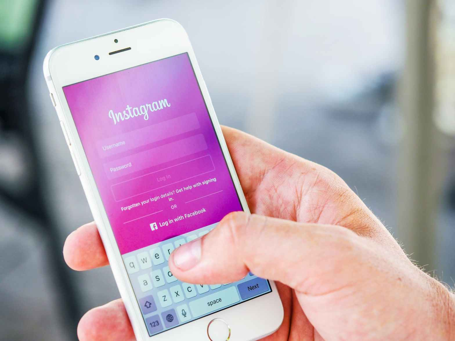 improve your social media presence: smartphone with instagram app pulled up on screen